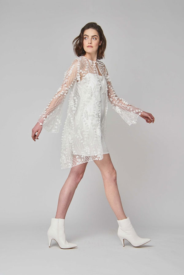 Short wedding dress with sheer cover up and white boots by Alexandra Grecco best wedding dresses from Bridal Fashion Week Spring 2019