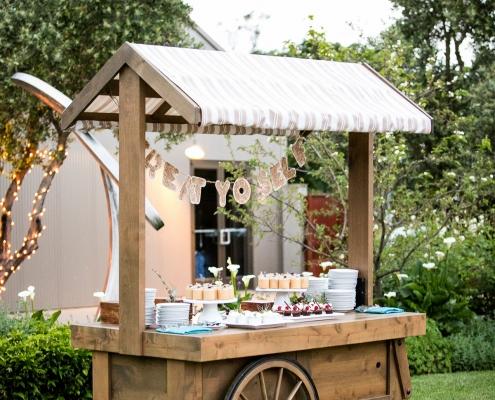 Vintage dessert bar cart at a wedding at Cornerstone Sonoma by Destination wedding planner Mango Muse Events