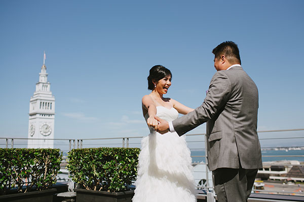 Bride and groom first look on their wedding day at the Hotel Vitale in San Francisco by Destination wedding planner Mango Muse Events