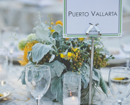 Grey green and yellow wedding tablescape with travel locations as table names at a Los Altos History Museum wedding by Destination wedding planner Mango Muse Events