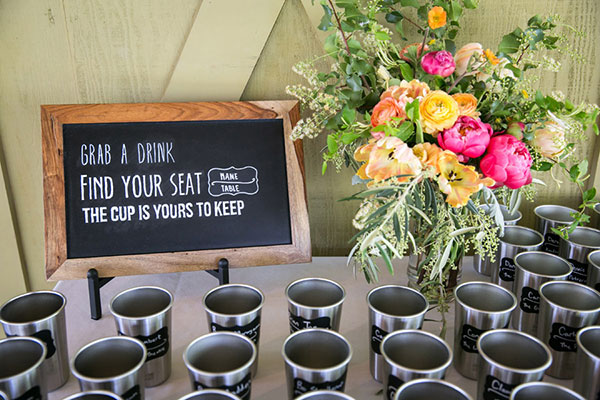Escort cups for guests to keep at an eco-friendly Sonoma destination wedding by Destination wedding planner Mango Muse Events