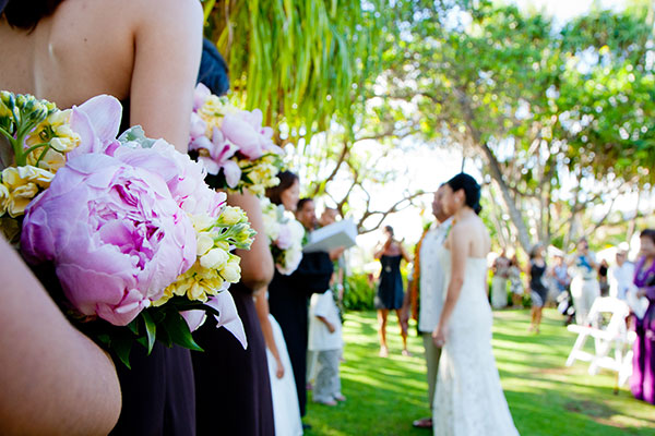 An outdoor wedding ceremony at Lanikuhonua in Hawaii by Destination wedding planner, Mango Muse Events