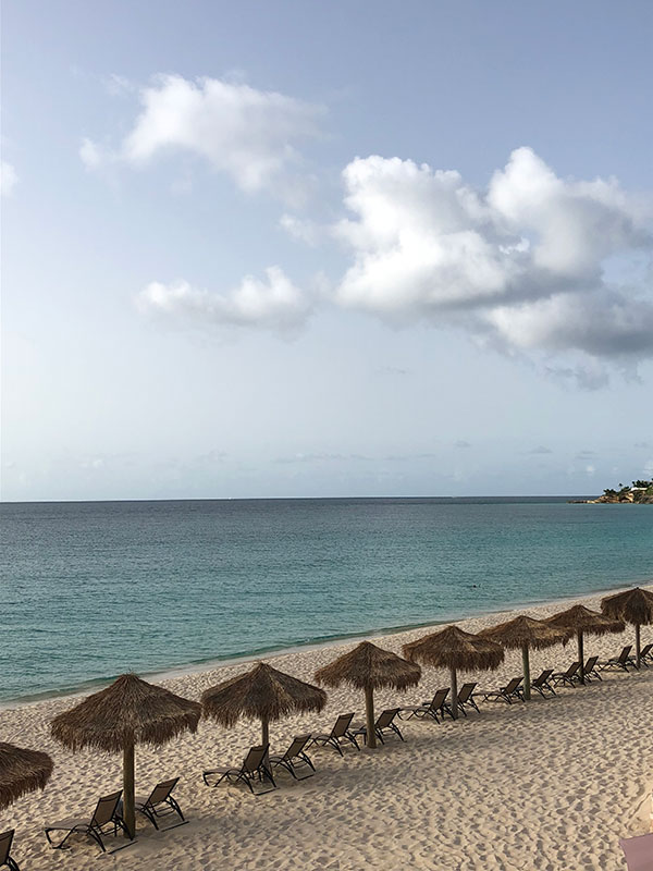 Palapas on the Meads Bay beach in Anguilla for a Caribbean destination wedding by Destination wedding planner Mango Muse Events
