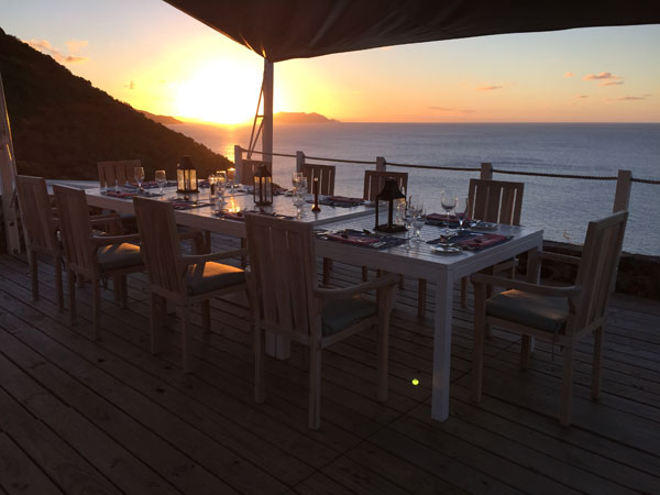 Private rehearsal dinner at sunset on Guana Island in the BVI for a Caribbean destination wedding by Destination wedding planner, Mango Muse Events