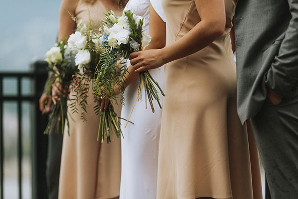 Nude bridesmaid dresses and simple white wedding bouquets for a destination wedding in Vancouver by Destination wedding planner Mango Muse Events