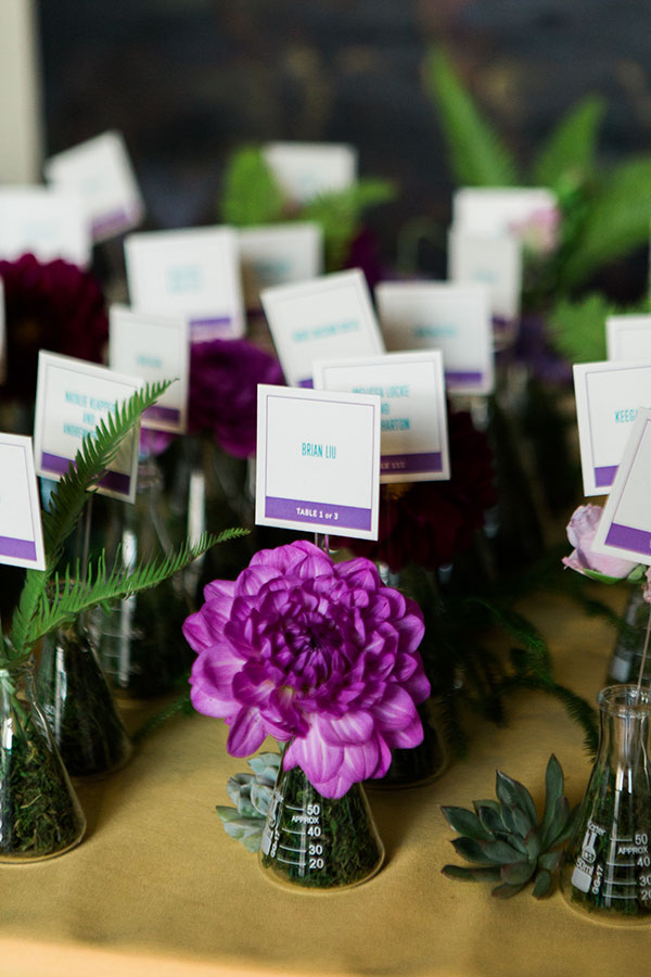 Beaker escort cards for a science inspired wedding in San Francisco by Destination wedding planner Mango Muse Events