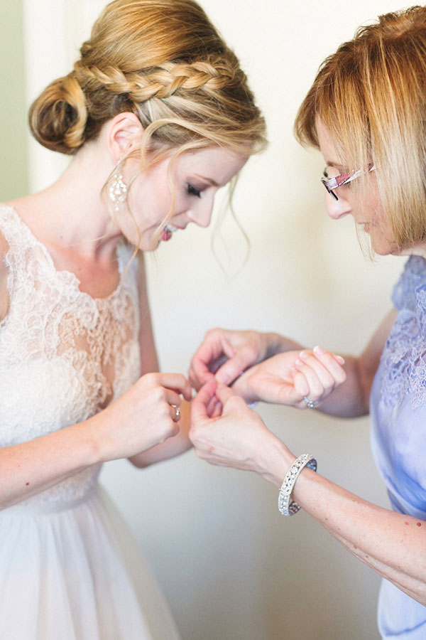 Mother of the bride helping the bride get ready on her wedding day by Destination wedding planner Mango Muse Events