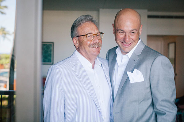 Groom and the father of the groom having a moment together before the ceremony at a Hawaii wedding on the Big Island by Destination wedding planner Mango Muse Events