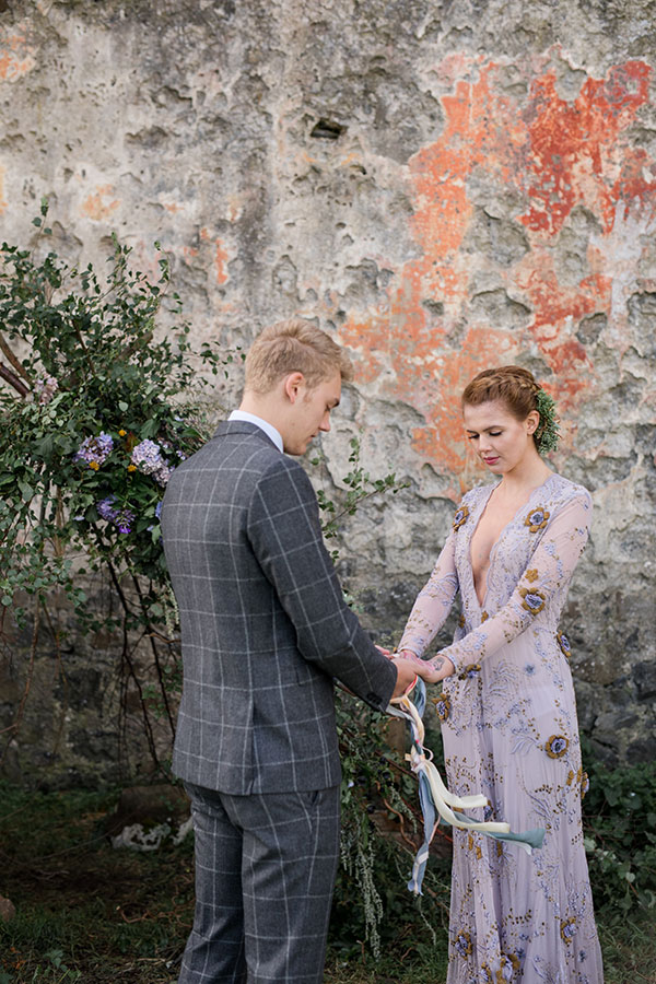 Traditional handfasting ceremony at a destination wedding in Scotland in the Isle of Skye by Destination wedding planner Mango Muse Events