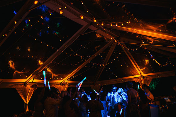 Wedding guests dancing the night away at a wedding in Hawaii by Destination wedding planner Mango Muse Events