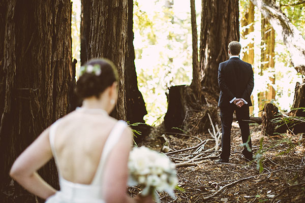 Bride and groom doing their first look at woodland wedding in Santa Cruz by Destination wedding planner Mango Muse Events