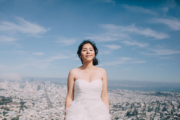 A relaxed bride enjoying the view at a San Francisco destination wedding by Destination wedding planner Mango Muse Events
