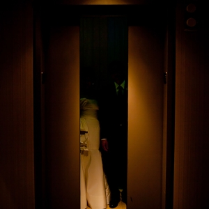 Wedding couple in an elevator at a hotel wedding in San Francisco by Destination wedding planner Mango Muse Events