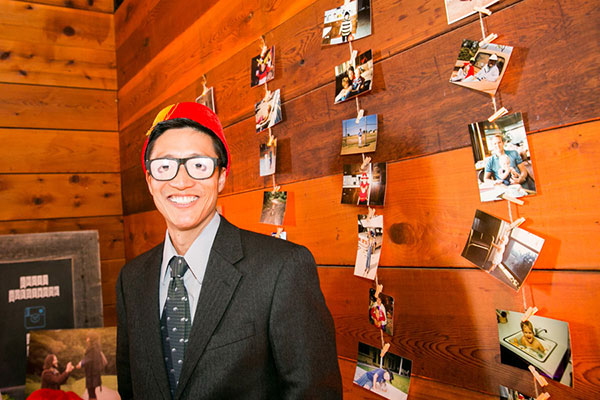 Guest playing with fun props at a wedding photobooth at a barn wedding by destination wedding planner Mango Muse Events