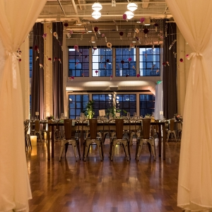 Big reveal of the wedding reception at an industrial art gallery wedding venue Terra gallery in San Francisco by Destination wedding planner Mango Muse Events