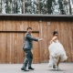 Groom chasing bride at their San Francisco wedding at Stern Grove by destination wedding planner Mango Muse Events