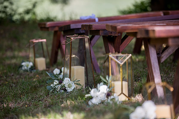 Gold lanterns and white flowers for a rustic wedding ceremony in Monte Rio by Destination wedding planner Mango Muse Events