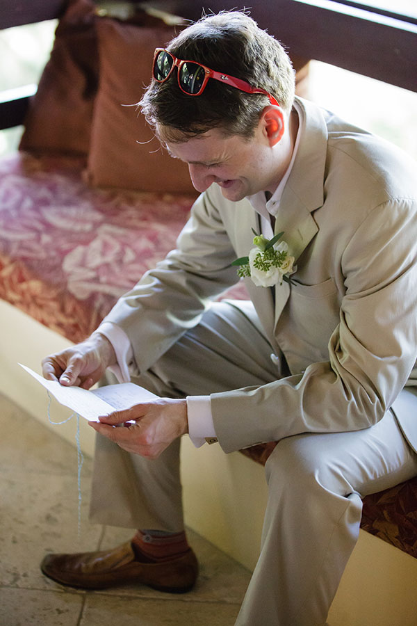 Groom reading a letter at his St. Croix destination wedding in the Caribbean by Destination wedding planner Mango Muse Events