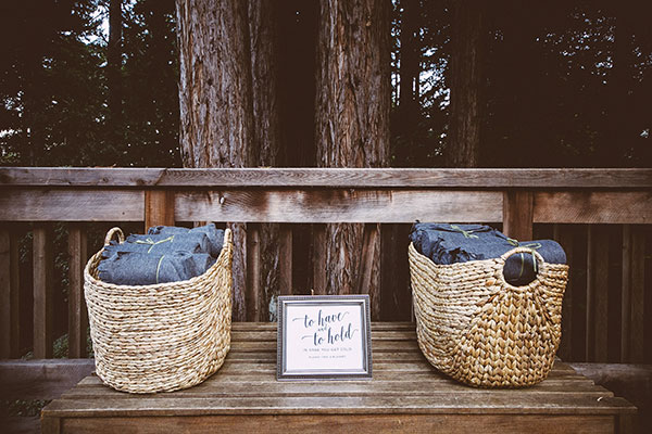 Wedding blankets for guest to keep warm at a fall wedding in the redwoods in Ben Lomond by Destination wedding planner Mango Muse Events