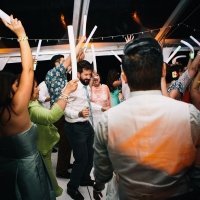 Wedding guests dancing and having a great time at a private estate destination wedding in Hawaii by Destination wedding planner Mango Muse Events
