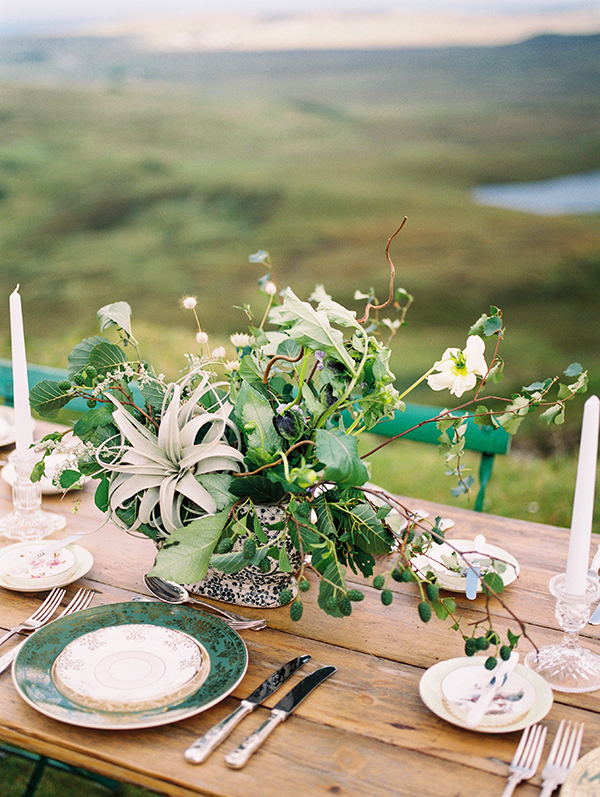 Airplant centerpiece, vintage dishware and green chairs for a Scotland destination wedding on the Isle of Skye by Destination wedding planner Mango Muse Events