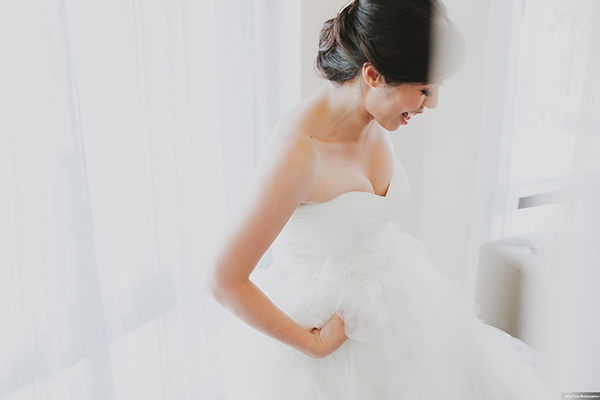 Happy bride getting ready at her San Francisco wedding by Destination wedding planner Mango Muse Events