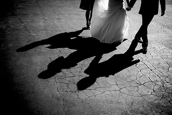 Bride and groom walking hand in hand at their Sonoma wedding by Destination wedding planner Mango Muse Events