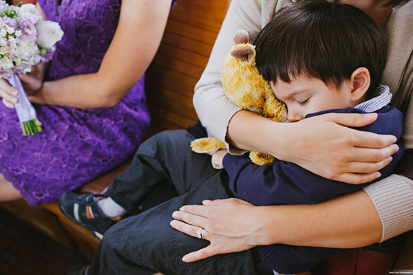 Ring bearer sleeping at a wedding in San Francisco by Destination wedding planner Mango Muse Events