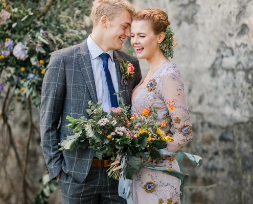 Bride and groom happy at their Scotland wedding ceremony in church ruins on the Isle of Skye by Destination wedding planner Mango Muse Events
