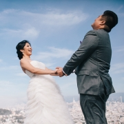 Bride and groom celebrating their wedding day with a beautiful San Francisco view by destination wedding planner, Mango Muse Events