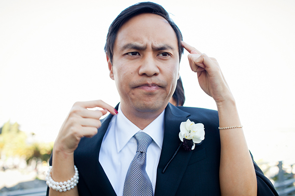 Groom making a funny face at his wedding in San Francisco by Destination wedding planner Mango Muse Events