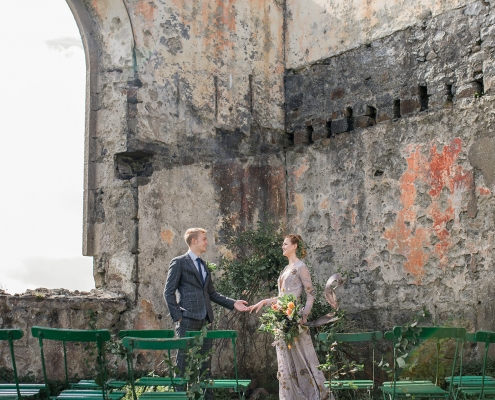 Bride and groom at their wedding ceremony in some ruins in Scotland on the Isle of Skye by destination wedding planner Mango Muse Events