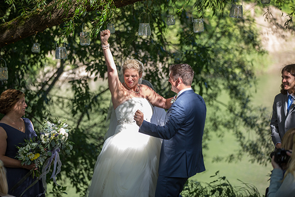 Bride and groom just married fist pump at their Monte Rio wedding by Destination wedding planner Mango Muse Events