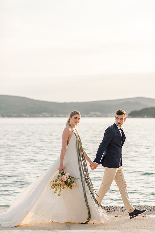 Bride and groom heading to their destination wedding reception on a yacht in Croatia by Destination wedding planner Mango Muse Events