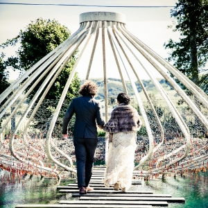 Bride and groom walking to an art installation sculpture at their Cornerstone Sonoma wedding by Destination wedding planner Mango Muse Events
