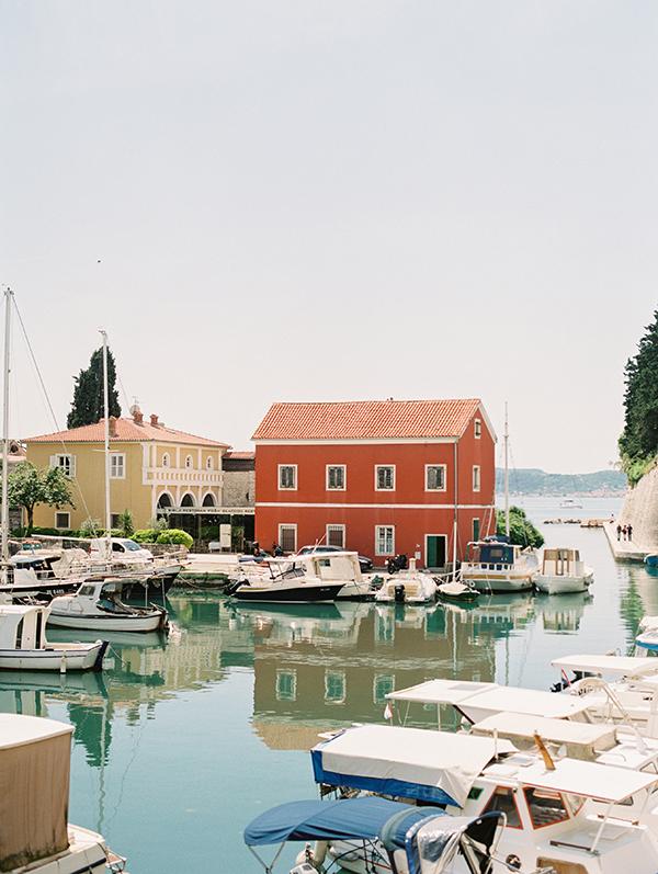 Orange red colored building and boats in Zadar, Croatia