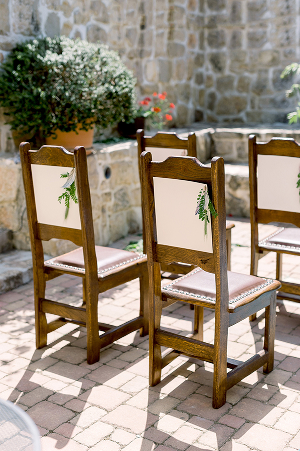 Ceremony chairs and hand painted leaf accents for a destination wedding in Croatia by Destination wedding planner Mango Muse Events