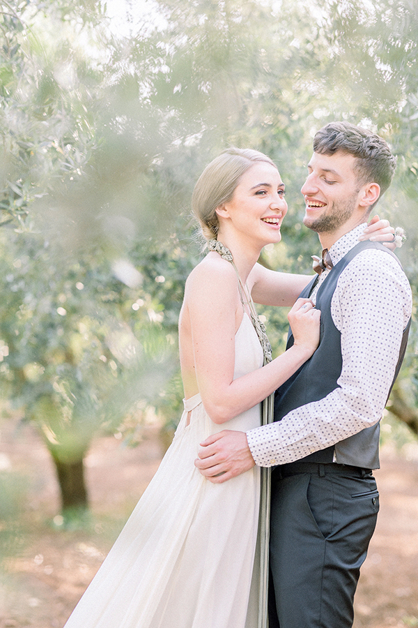 Couple laughing in an olive grove at a Croatian destination wedding by Destination wedding planner Mango Muse Events