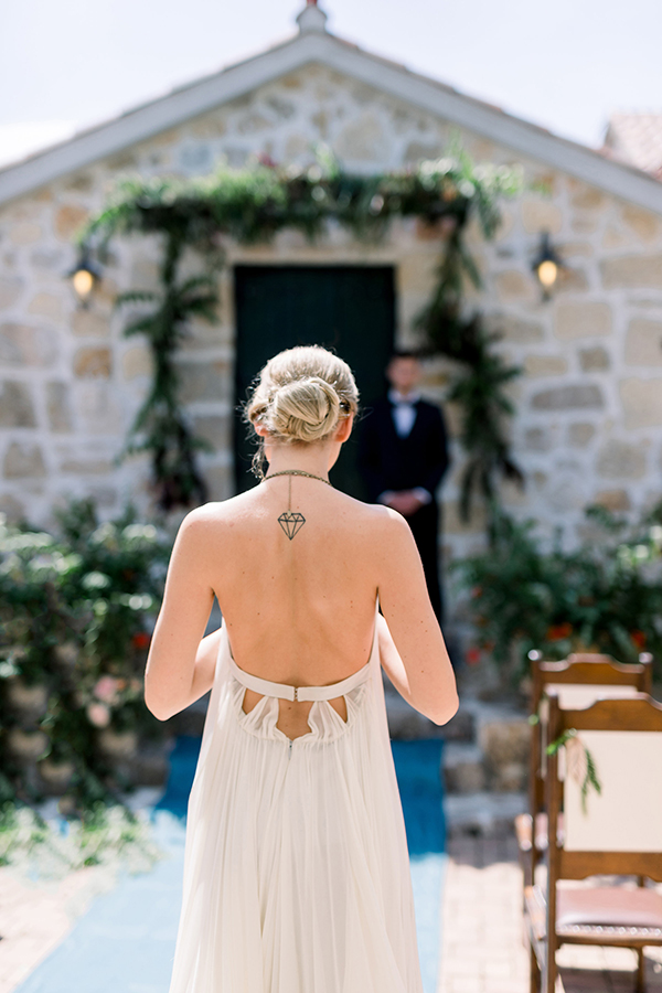 Wedding ceremony bride walking down the aisle at a Croatian destination wedding by Destination wedding planner Mango Muse Events
