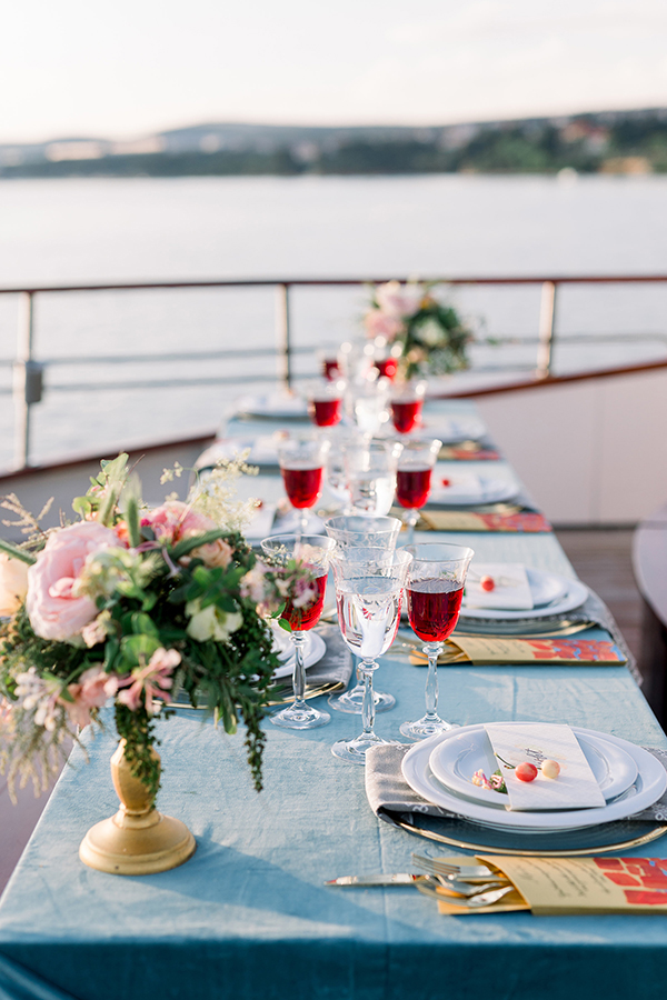 Wedding reception table on a yacht for a destination wedding in Croatia by Destination wedding planner Mango Muse Events