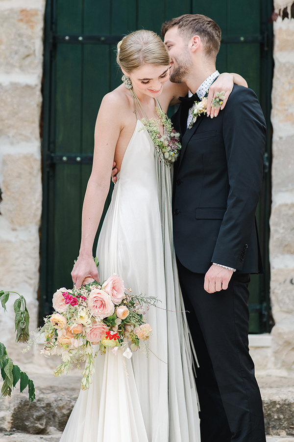 A whisper between the bride and groom at their wedding ceremony in Croatia by Destination wedding planner Mango Muse Events