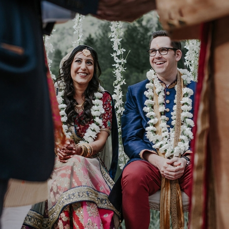 Happy bride and groom at their multicultural Hindu wedding ceremony in Calistoga by destination wedding planner Mango Muse Events