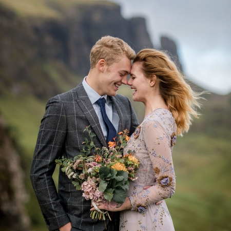 Bride and groom laughing at their destination wedding on the Isle of Skye in Scotland by destination wedding planner Mango Muse Events
