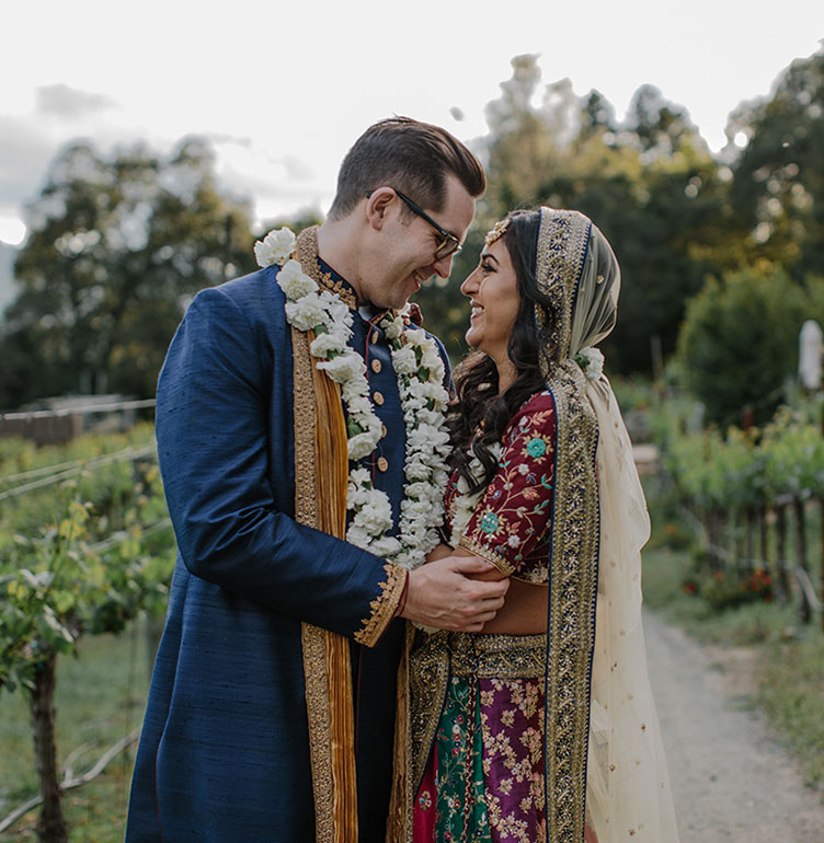 Bride and groom at their multicultural Hindu wedding in wine country at Calistoga Ranch by destination wedding planner Mango Muse Events