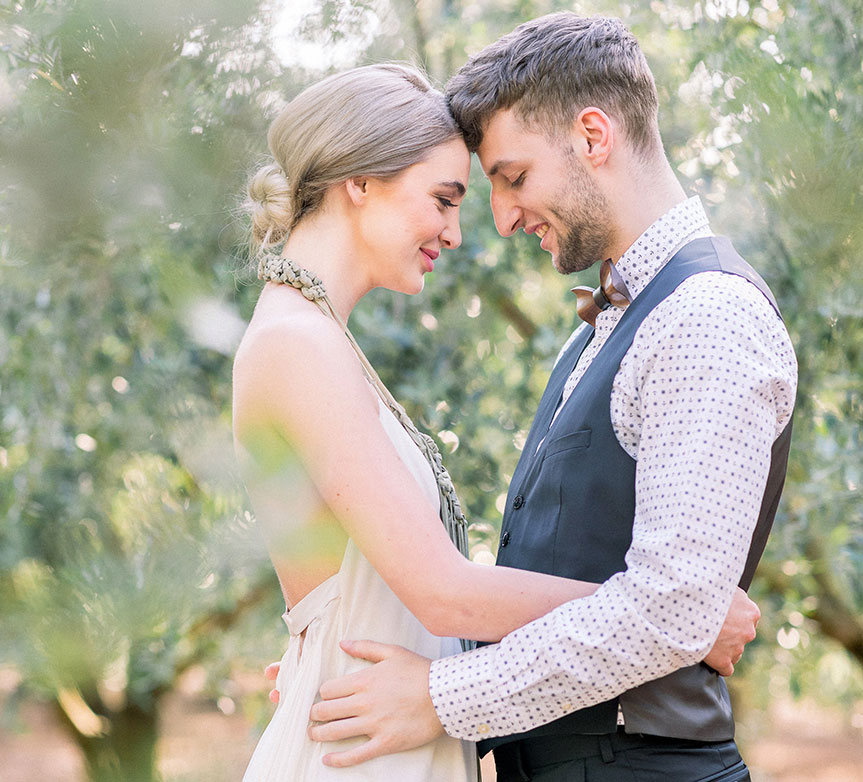 Bride and groom in the olive grove at a destination wedding in Croatia by Destination wedding planner Mango Muse Events