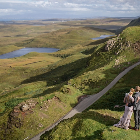 Bride and groom enjoying the view at the Quiraing at their destination wedding on the Isle of Skye in Scotland by destination wedding planner Mango Muse Events