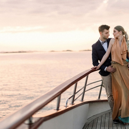 Bride and groom enjoying a Croatia sunset at their wedding reception on a yacht by destination wedding planner Mango Muse Events