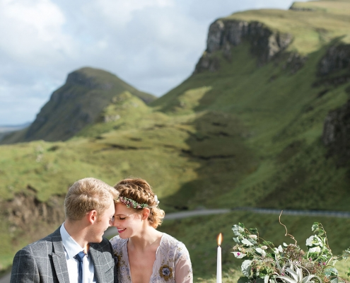 Bride and groom at their wedding reception table at their Isle of Skye destination wedding in Scotland by destination wedding planner Mango Muse Events