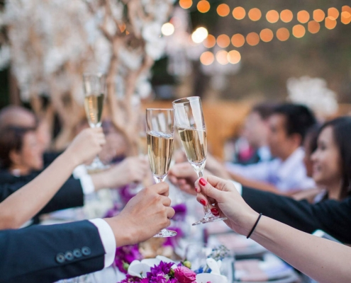 Wedding guests toasting with champagne at a luxury destination wedding at Calistoga Ranch by destination wedding planner Mango Muse Events