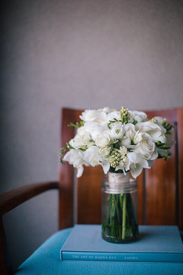 A classic white wedding bouquet for a destination wedding in Hawaii by destination wedding planner Mango Muse Events